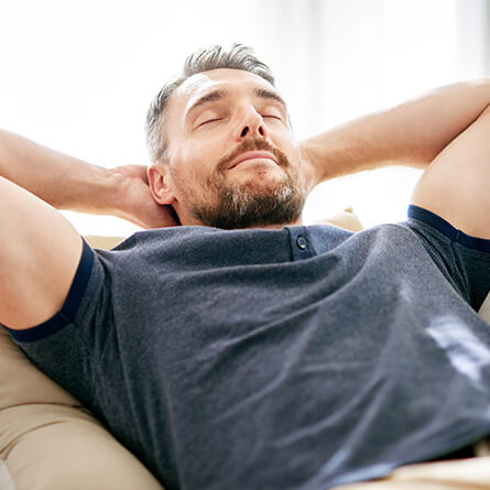 man relaxing with his eyes closed